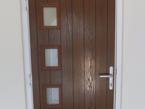 5 lever, wood effect UPVC contemporary door