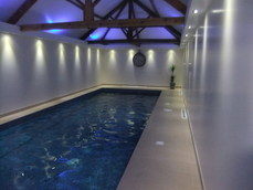 The finished swimming pool with hidden coloured up lighting and LED down lights