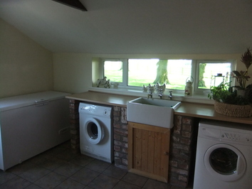 Refurbished laundry room with new window and belfast sink