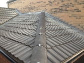 Extension with concrete tiles and dry ridge system