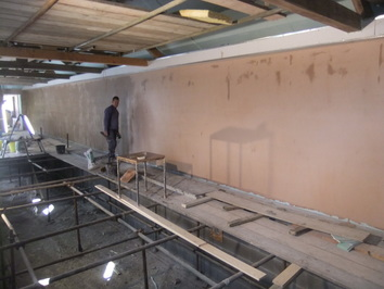 Swimming pool walls in the process of being plastered