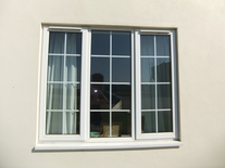 White UPVC A Rated window with Georgian bar inserts