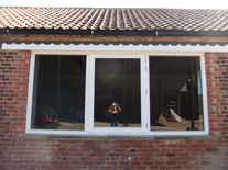 9' long x 5' high, handmade timber window with bronzed double glazed glass